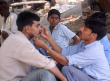 Varanasi, India, street barber. Indian men shaving outside in Varanasi, India Royalty Free Stock Images