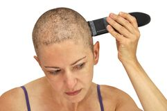 Shaving left closeup. Woman shaving herself bald using left hand, closeup, isolated on white Royalty Free Stock Photo