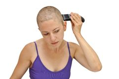 Shaving left. Woman in purple bodice shaving herself bald using left hand, isolated on white Royalty Free Stock Photography
