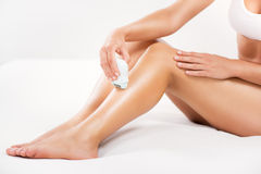 Shaving leg royalty free stock images