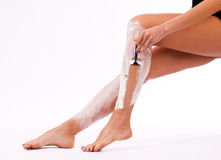 Beautiful Slander Woman Shaving Legs Cream Stock Photo