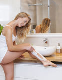 Shaving legs Royalty Free Stock Image