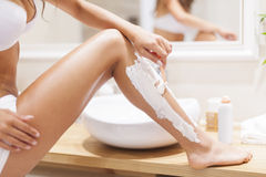 Shaving legs Royalty Free Stock Photos