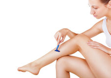 Shaving legs Royalty Free Stock Photography