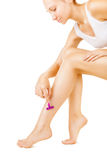 Shaving legs Royalty Free Stock Images