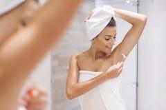 Shaving legs. Woman shaving armpit in bathroom Royalty Free Stock Photography