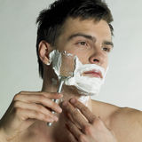 Shaving man Stock Photo