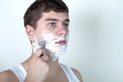 Shaving man Royalty Free Stock Photo
