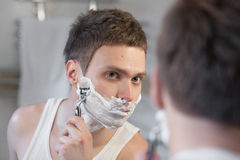 Shaving man Royalty Free Stock Image