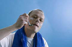 Shaving man stock photography