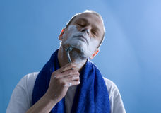 Shaving man Royalty Free Stock Photo