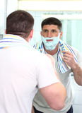 Shaving man with razor Stock Photo
