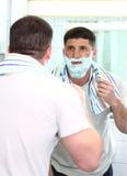 Shaving man with razor Stock Photo