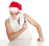 Shaving man in red Christmsa hat Stock Image