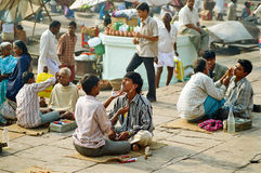 Shaving Men in Varanasi Ghat, India royalty free stock photo