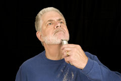 Shaving Off The Beard Revised. A middle aged man continues the process of shaving off his beard Royalty Free Stock Photos