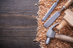 Shaving plane claw hammer flat chisels and wooden Royalty Free Stock Photography