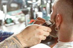 Shaving process in barber shop Stock Photography