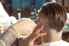 Shaving process in barber shop Royalty Free Stock Image