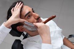 Shaving process Barbershop face closeup Stock Photography