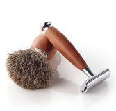 Shaving razor and brush Stock Images