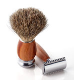 Shaving razor and brush Stock Photos