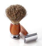 Shaving razor and brush. Wooden shaving razor and brush on white background stock photos