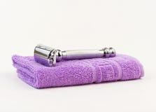 Shaving razor and towel Stock Photo