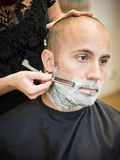 Shaving situation. At the hair salon close-up stock photography