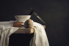 Shaving Tool on wooden Table and dark Background Stock Photo