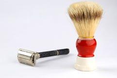 Shaving tools. Photo of shaving brush and razor Stock Photos