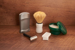Shaving tools on a wooden surface Royalty Free Stock Photo