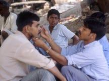Shaving Varanasi. Indian man shaving outside in Varanasi, India Royalty Free Stock Photo