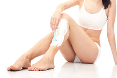 Shaving woman's legs, concept. Close up, shaving woman's legs, isolated on white royalty free stock photo