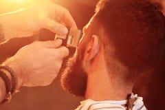Shaving your beard in barbershop royalty free stock photo