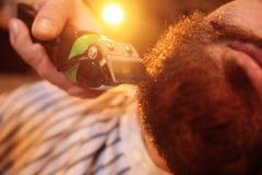 Shaving your beard in barbershop stock photography