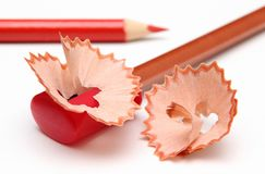 Shavings. With a red pencil-sharpener and shavings stock images