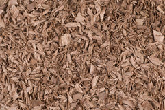 Shavings mahogany. Excellent background of red wood, chips can be used as a texture for design artworks, shavings and sawdust mahogany, artist produced an Royalty Free Stock Photo