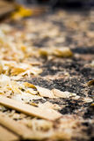 Shavings of wood and sawdust on the floor of a carpenter`s works Royalty Free Stock Photo