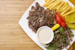 Shawarma Beef Plate. Served with fries tomato Tahini and parsley royalty free stock photos