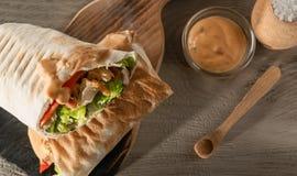 Shawarma with chicken and tomato. stock photo