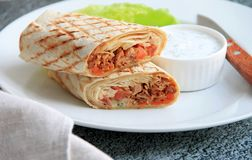 Shawarma with chicken, vegetables and salad stock images