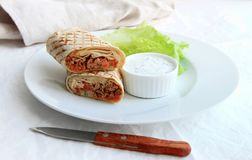 shawarma with chicken, vegetables and salad on a plate royalty free stock image