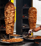Shawarma. Closeup picture of stacked meat roasting, shawarma stock photography