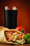 Shawarma and cola. Still life with traditional shawarma, vegetables and cola royalty free stock photo