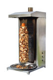 Shawarma cooking in vertical spit oven. Photo of Shawarma vertical over Isolated on white background stock photos
