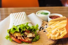 Shawarma and french fries stock photo