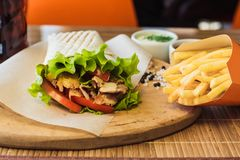 Shawarma and french fries stock photography