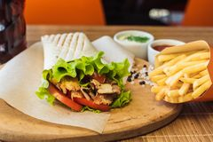 Shawarma and french fries royalty free stock image