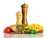 Shawarma with Fries Isolated on White Background. Shawarma Sandwich with French Fries and Fresh Vegetables Isolated on White Background royalty free stock photography
